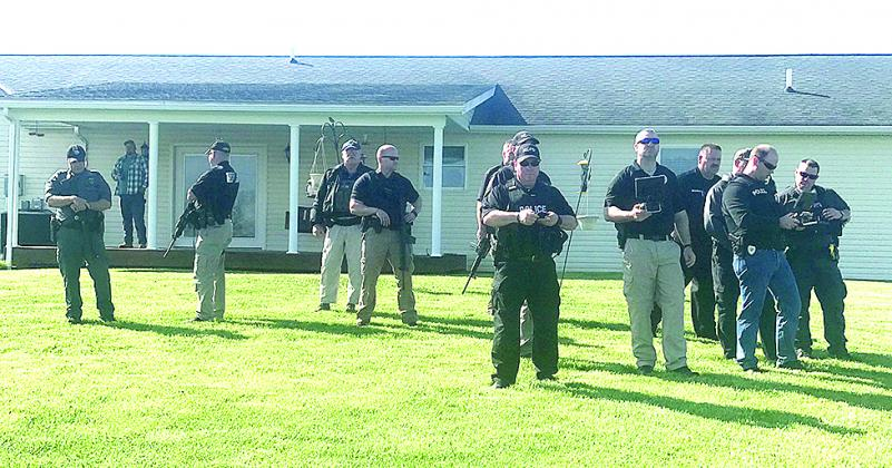 Police awaited directions during the hunt for Justin Mann. Keith Smith